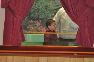 Bro. Andrew Young being baptized by Pastor Young.