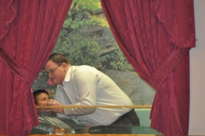 Bro. Damian Marine being baptized by Pastor Young.