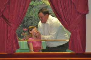 Sis. Jacey Jenkins being baptized by Pastor Young.