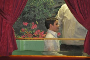 Bro. James Glasscock being baptized by Pastor Young.