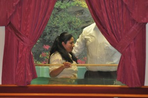 Sis. Maria Marine being baptized by Pastor Young.