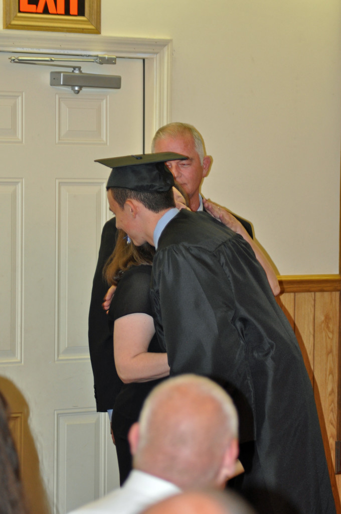 Mr. Michael Glasscock receiving his diploma by his parents Bro. Terry and Sis. Debbie Glasscock.