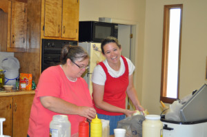 Mrs. Toni Sales and Mrs. Julie Jenkins getting condiments ready for the canteen Monday night.