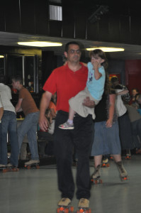 Bro. Michael Sales holding Elizabeth Young so she could skate some.  Look out Elizabeth if he falls.  That's a LONG ways to the floor.