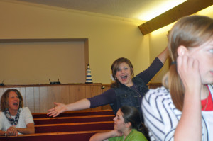 Is this a photo bomb, or is she trying to fly a plane in the church?
