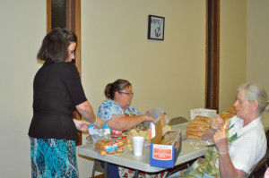 Mrs. Janice Light, Mrs. Toni Sales, and Ms. Kay Reese getting sandwiches ready for Wednesday.