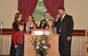 Bro. Randy Sutherland and his family singing for us during the service.