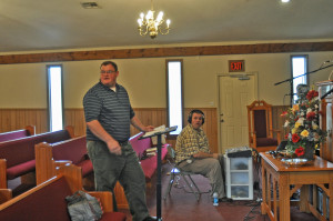 Pastor helping the youth choir and Bro. Jason holding doing the recording for us.