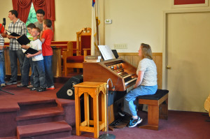 Sis. Jenny Young plays the organ for the youth choir.